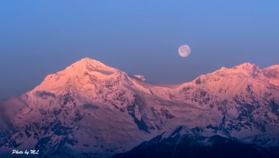 Full moon while sun rising at Meili Snow Mountains, Yunnan